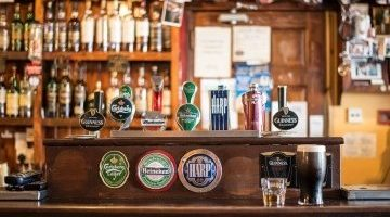Picture of a bar viewing the beers on tap including Heineken, Carlsberg, Guinness and Budweiser